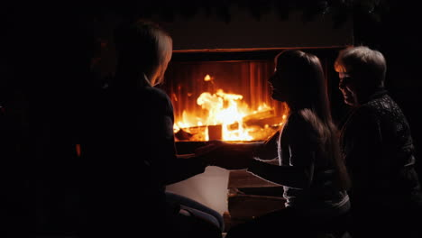 Silhouettes-Of-People-Playing-By-The-Fireplace