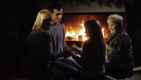 Cheerful-Family-Plays-By-The-Fireplace-Have-A-Good-Time-Together