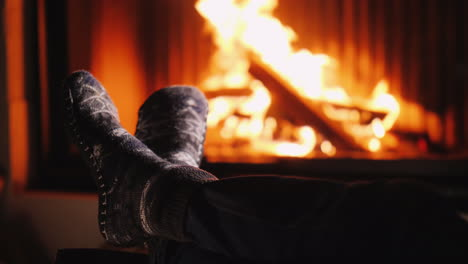 A-Man-In-Warm-Socks-Warms-His-Feet-By-The-Fireplace