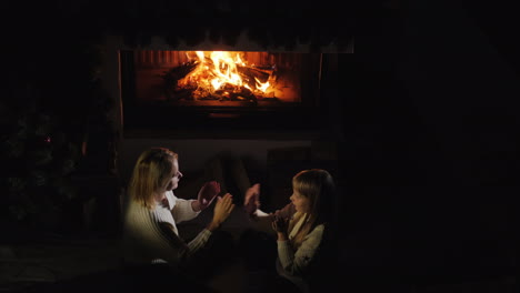 Mom-And-Daughter-Play-By-The-Fireplace-In-The-Evening-A-Cozy-Warm-House