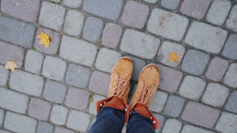 Feet-In-Autumn-Boots-On-The-Sidewalk-The-Camera-Rotates