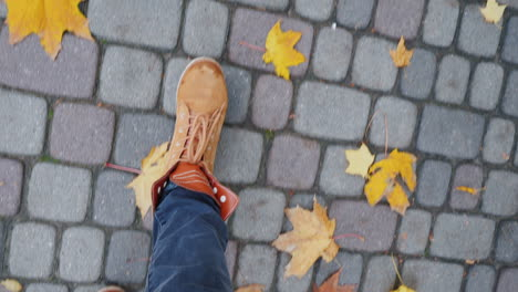 Female-Legs-In-Boots-Go-Along-The-Sidewalk-Where-The-Fallen-Autumn-Leaves-Lie-Pov-Video