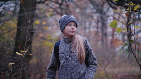 A-Little-Girl-Walks-Through-The-Woods-At-Dusk-A-Child-Lost-In-The-Woods