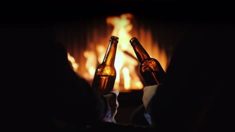 Male-Rest-With-Beer-By-The-Fireplace-Winter-Escape-4k-Video