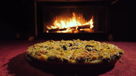 A-Group-Of-People-Takes-A-Slice-Of-Pizza-Delicious-Pizza-By-The-Fireplace