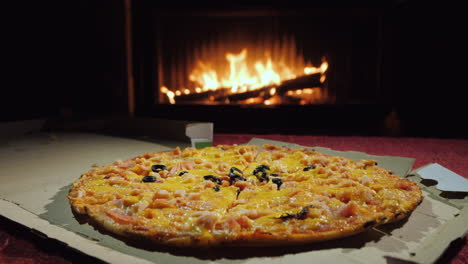 A-Tasty-Pizza-Is-Taken-Piece-By-Piece-A-Group-Of-People-Dinner-By-The-Fireplace
