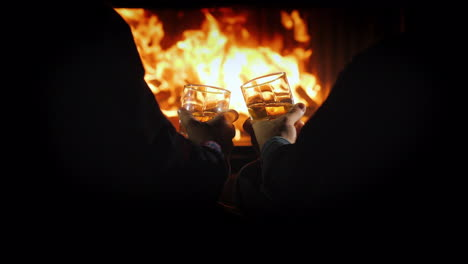 Men-With-Glasses-Of-Strong-Alcohol-Are-Resting-By-The-Fireplace-Winter-Escape
