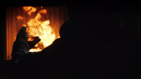 Taste-Cognac-Sitting-By-The-Fireplace
