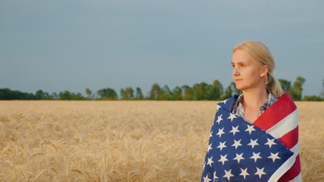 Woman-Farmer-With-Usa-Flag-On-Weeds-Walking-Along-Wheat-Field