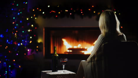 Lonely-Woman-Meets-Christmas-Alone-By-The-Fireplace-With-A-Glass-Of-Wine