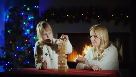 Christmas-Holidays-Together---Mother-And-Daughter-Play-A-Board-Game