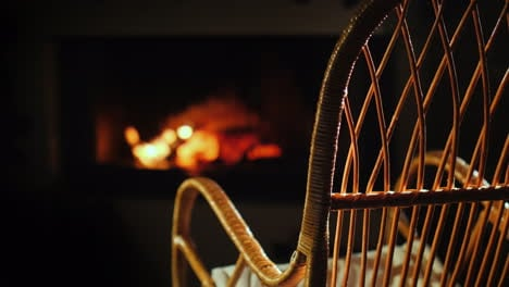An-Empty-Rocking-Chair-Sways-By-The-Fireplace-Next-To-A-Set-For-Needlework-A-Place-For-Winter-Holida