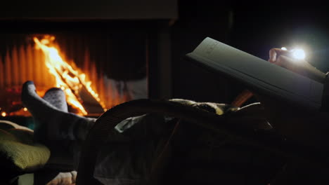 A-Man-Begins-To-Write-On-A-Blank-Page-Of-A-Notebook-Sits-By-The-Fireplace