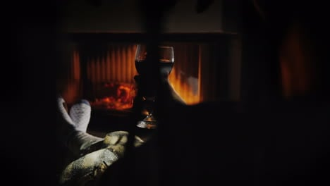 A-Cozy-Evening-By-The-Fireplace-With-A-Glass-Of-Wine-In-Hand-Winter-Holidays