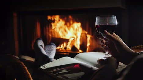Sitting-By-The-Fireplace-With-A-Blank-Notebook-And-A-Glass-Of-Wine---Planning-A-New-Life-Concept