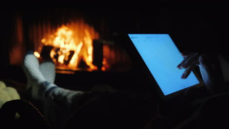 Use-A-Tablet-By-The-Fireplace-In-A-Cozy-Home-Environment