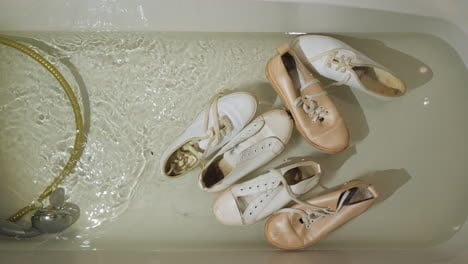 Dirty-Women-s-Shoes-Float-In-The-Bathtub-And-Sap