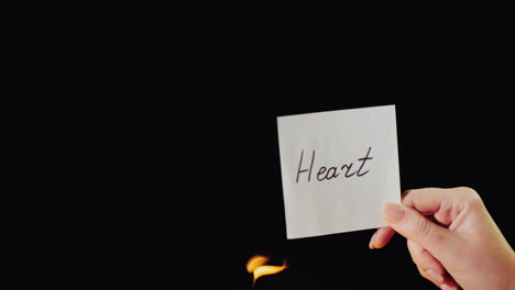 Man-Burns-A-Paper-With-The-Inscription-Heart