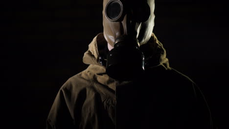 A-Man-In-A-Protective-Suit-And-Gas-Mask-Smoke-In-The-Foreground