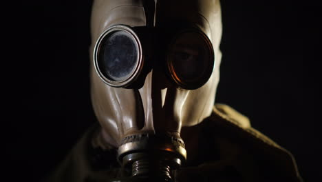 The-Gleams-Of-The-Fire-Are-Reflected-In-The-Eye-And-Gas-Mask-Of-The-Man
