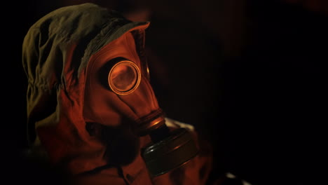A-Man-In-A-Gas-Mask-Looks-At-The-Fire-The-Flame-Is-Reflected-In-The-Mask