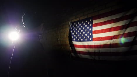 A-Young-Soldier-In-The-Spotlight-Looks-At-The-Us-Flag