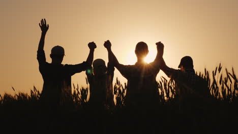 The-Team-Of-Farmers-Raise-Their-Hands-Up-Together-In-A-Sign-Of-Success-And-Confidence-In-The-Team