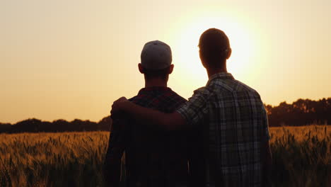 Two-Men-Gently-hug-while-looking-at-a-wheat-field