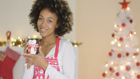 Pretty-young-housewife-relaxing-at-Christmas