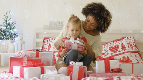Daughter-and-mother-in-bed-with-Christmas-gifts