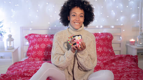 Pretty-woman-admiring-her-Christmas-coffee-cup