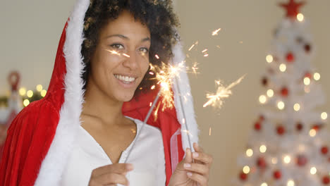 Cute-friendly-young-woman-celebrating-Christmas