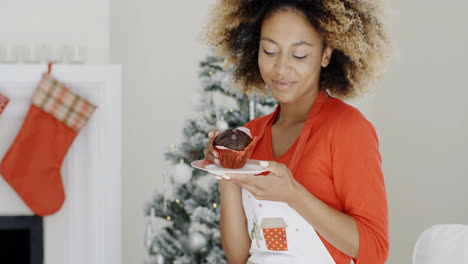 Happy-young-woman-celebrating-Christmas