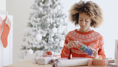 Attractive-young-woman-wrapping-Christmas-gifts