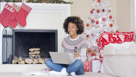 Young-woman-doing-Christmas-shopping-online