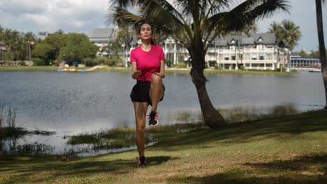 Active-woman-doing-exercises-on-lakeside