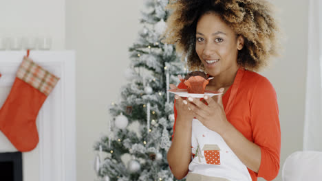 Pretty-young-woman-with-a-Christmas-cake