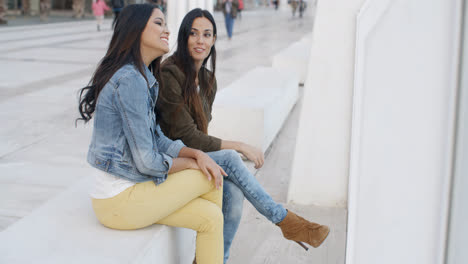Two-trendy-young-women-relaxing