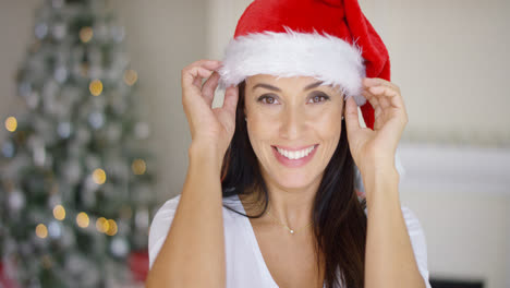 Lovely-young-woman-in-a-red-Santa-hat