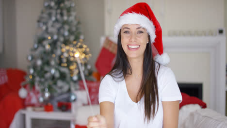 Laughing-young-woman-burning-an-Xmas-sparkler