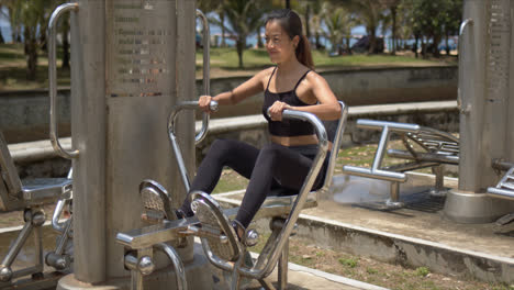 Strong-woman-using-leg-press-machine