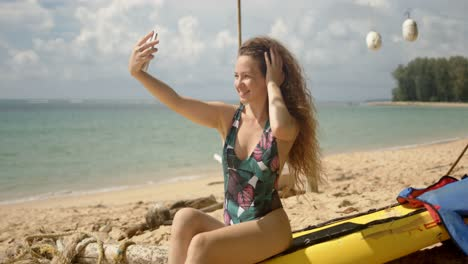 Attractive-woman-taking-selfie-on-beach