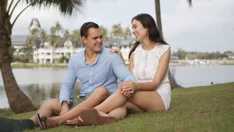 Content-resting-couple-having-rest-on-grass-on-vacation