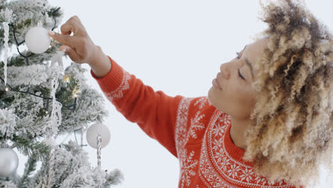 Attractive-woman-decorating-an-Xmas-tree