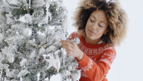 Attractive-woman-preparing-the-tree-for-Christmas