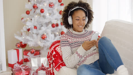 Attractive-woman-listening-to-music-at-Christmas