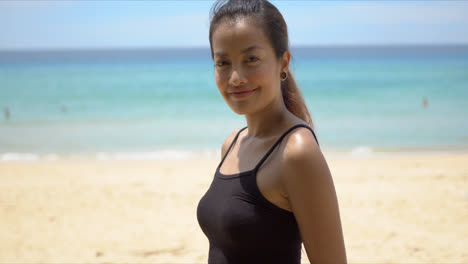 Woman-during-fitness-training-on-beach