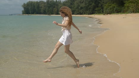 Active-woman-running-on-tiptoe-barefoot-on-beach
