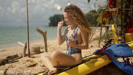 Relaxed-woman-enjoying-music-on-tropical-beach