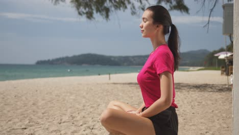 Young-woman-meditating-on-beach